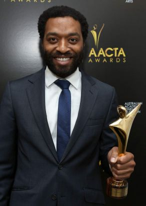 Actor Chiwetel Ejiofor poses with the Best Lead Actor award.