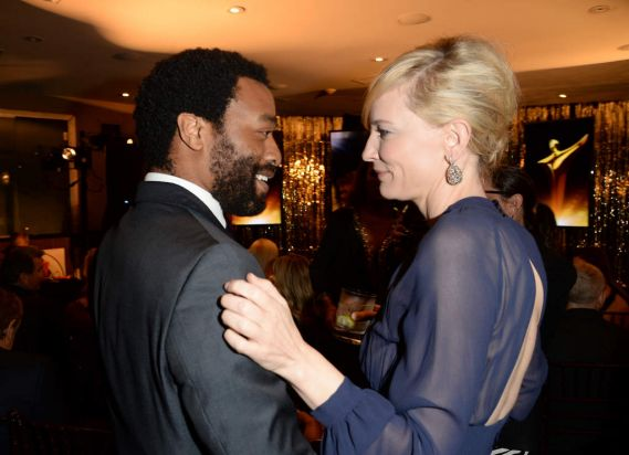 Actors Chiwetel Ejiofor and Cate Blanchett have a chat prior to the start of the awards.