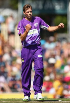 Crucial wicket: Ben Laughlin of the Hurricanes celebrates dismissing Usman Khawaja.