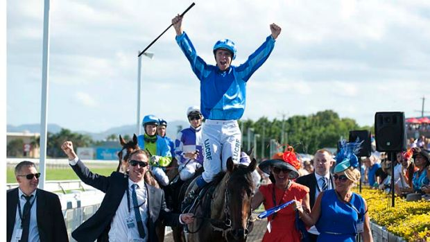 Jockey Nathan Berry celebrates after riding Unencumbered to victory.