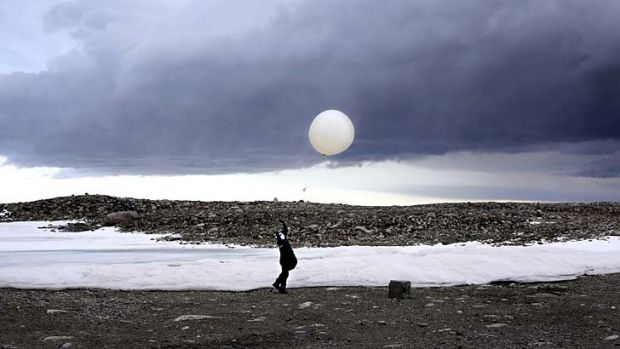 Up, up and away: Steven Black launches a weather balloon at Casey station in Antarctica.