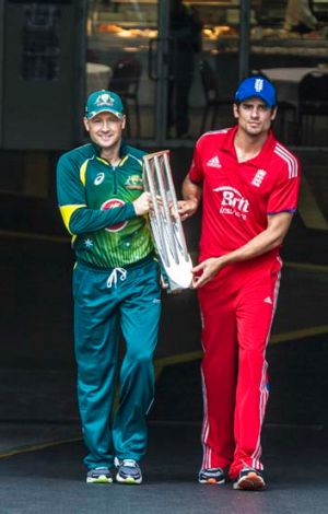 It's mine: Michael Clarke and Alastair Cook with the spoils.