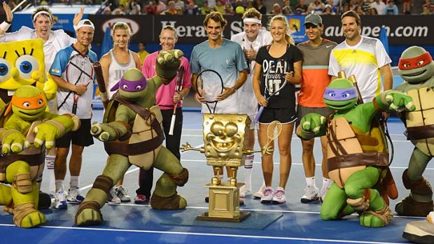 Star power: Teenage Mutant Ninja Turtles upstage the players at Saturday's Kids Tennis Day at Melbourne Park.
