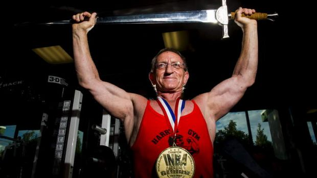 Harry Haueliuk with the broadsword he was awarded last year for international lifetime achievement in bodybuilding.