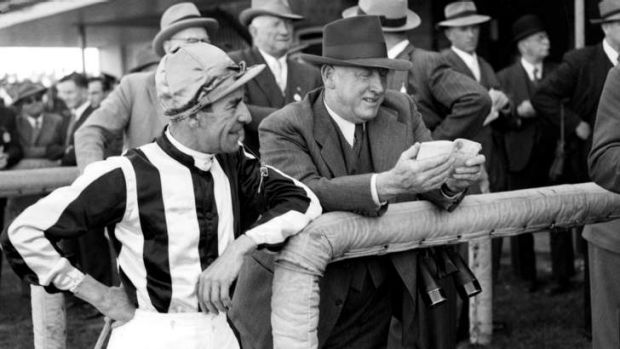 Jockey Darby Munro pictured with trainer Ted Hush at Sydney's Rosehill Racecourse on 22 September 1952, before their ...
