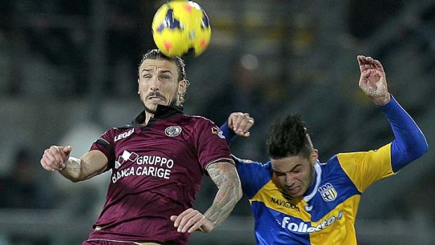 Paulinho of AS Livorno Calcio fights for the ball with Pedro Mendes of Parma FC.