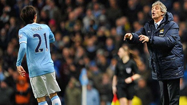 Blue moon rising: Manchester City manager Manuel Pellegrini is driving his team to new heights.
