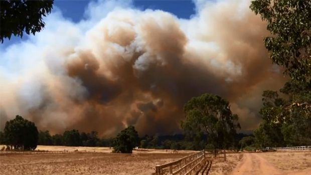 Huge smoke plumes billowed in the Shire of Mundaring on Sunday.