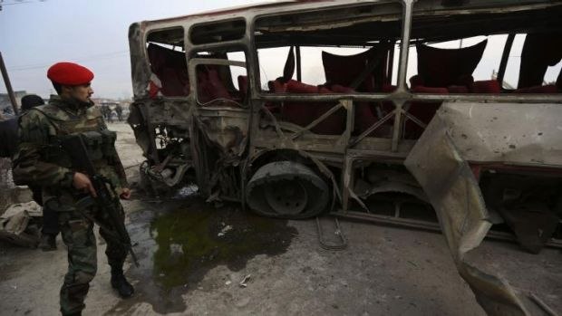Explosion: The wreckage of the bus hit by the suicide attack in Kabul.