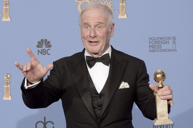 <i>Behind the Candelabra</i> producer Jerry Weintraub with the Golden Globe for best mini-series or TV movie.