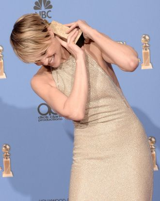 Robin Wright of <i>House of Cards</i> goofs around with her award.