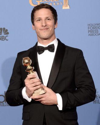 Andy Samberg of <i>Brooklyn Nine-Nine</i> with the Golden Globe for best actor in a TV series, musical or comedy.