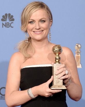 <i>Parks and Recreation</i> star Amy Poehler shows off her award for best actress in a TV series (musical or comedy).