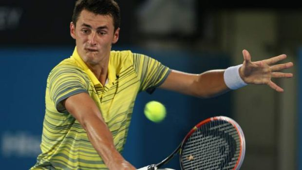 Bernard Tomic plays a backhander during the Sydney International final loss to Juan Martin Del Potro.
