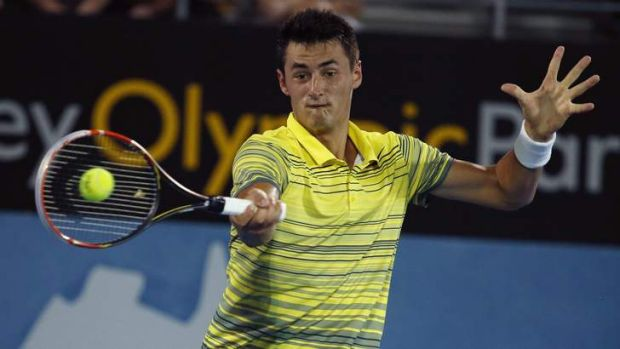 Bernard Tomic plays a forehand return to Juan Martin Del Potro of Argentina during the men's singles final at the Sydney ...