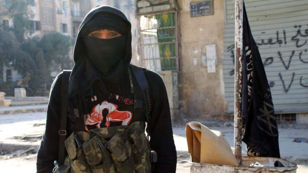 A member the Nusra Front stands in Aleppo.