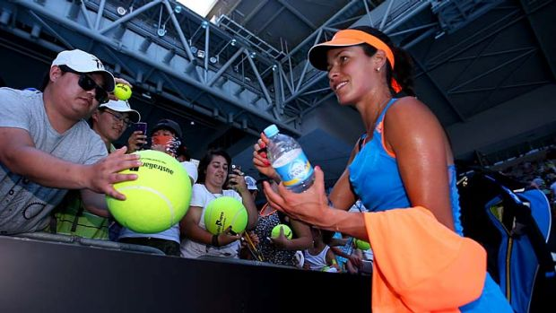 Successful run: Ana Ivanovic signs autographs after winning her first-round match.