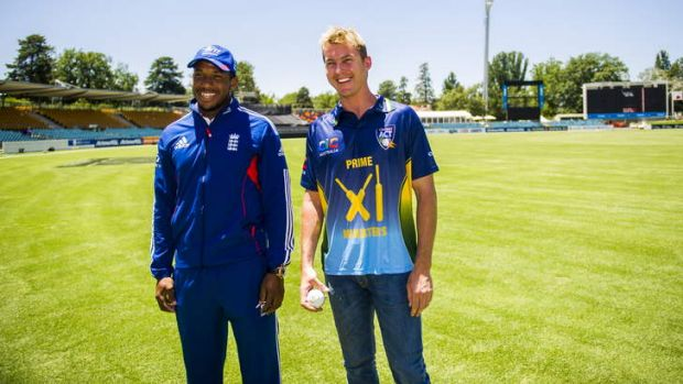 PM's XI skipper Brett Lee has a chat with England's Chris Jordan at Manuka Oval on Monday.