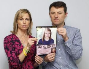 Kate and Gerry McCann hold a computer generated image of how their missing daughter Madeleine might look on May 2, 2012.