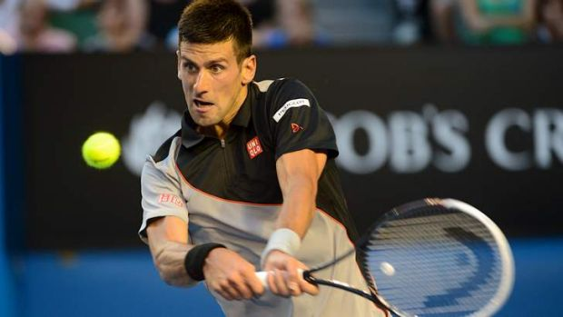 Novak Djokovic pings a backhand during his match against Lukas Lacko.