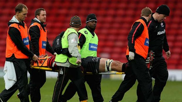 Stretchered off:  Alistair Hargreaves of Saracens leaves the pitch concussed a second time in a match between Saracens ...