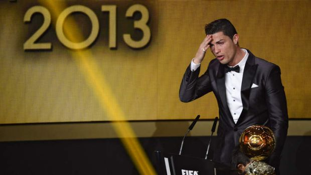 Real Madrid forward Cristiano Ronaldo delivers a speech after receiving the 2013 FIFA Ballon d'Or award for player of ...
