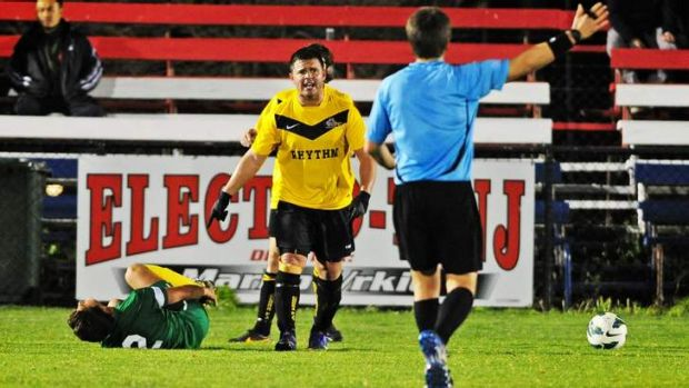 Foul play: Tuggeranong's Tomas Ruiz writhes on the ground after a tackle by Cooma's Jair Wilk in the 2013 Federation Cup ...