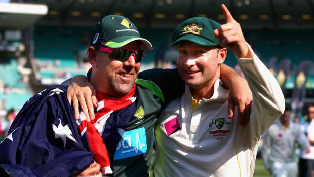 Darren Lehmann and Michael Clarke celebrate victory during day three of the fifth Ashes Test against England at the ...
