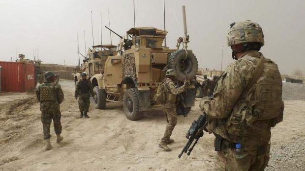Soldiers keep watch at the entrance of a US base in Panjwai district Kandahar province.
