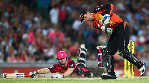 Near thing: Jordan Silk slides home to avoid a run-out against the Scorchers at the SCG on January 10.