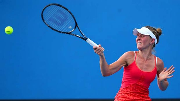 Olivia Rogowska plays a forehand in her first-round match against Mariana Duque-Marino of Colombia.