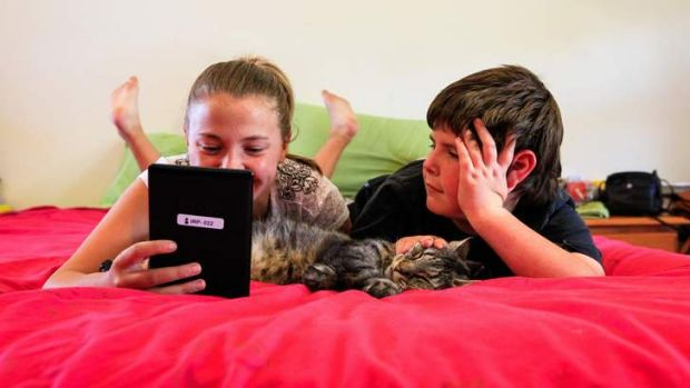 Jade Lewis, age 12, (pictured with 8 year-old brother Darcy) of Richardson received a kindle after improving her reading ...