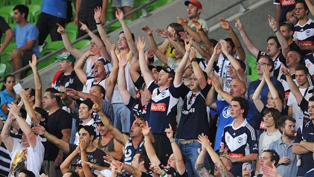 Victory supporters celebrate a goal in the second half.