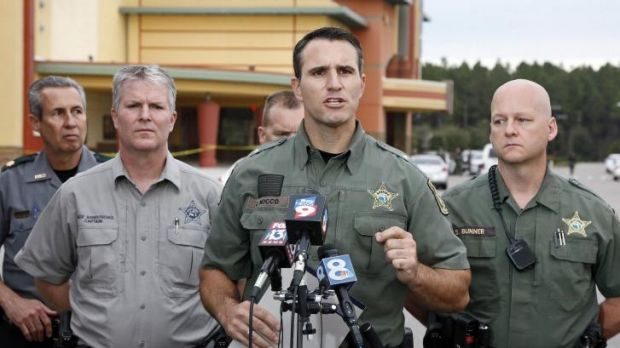 Pasco County Sheriff Chris Nocco (centre) speaks to the media as police tape surrounds the cinema in Wesley Chapel, ...