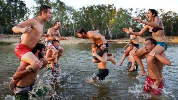French fruitpickers cool off in the Murray River at Cobram.