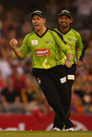At last: Mike Hussey celebrates a wicket.