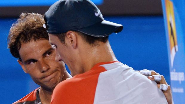 Australia's Bernard Tomic is comforted by Rafael Nadal after retiring in their first round match.