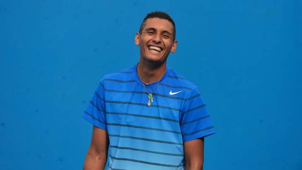 Nick Kyrgios enjoys a lighter moment during Wednesday's warm-up.