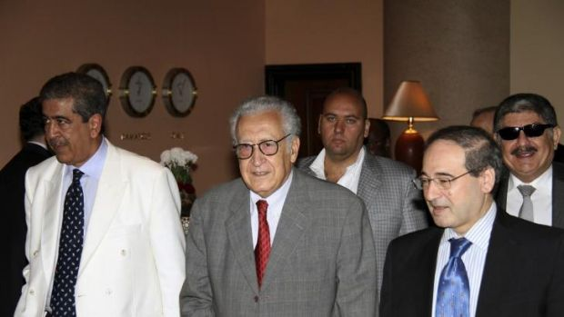 UN-Arab League peace envoy for Syria Lakhdar Brahimi (C) walks with Syrian Deputy Foreign Minister Faisal Mekdad (front ...