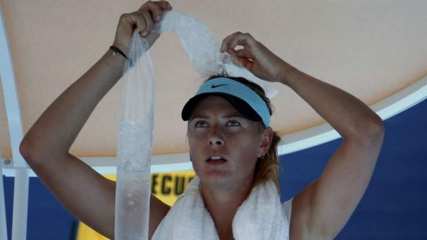 Maria Sharapova attempts to cool down during her marathon second-round match against Karin Knapp.