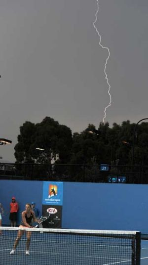 Lightning strikes as play continues on court 22 at the Australian Open.