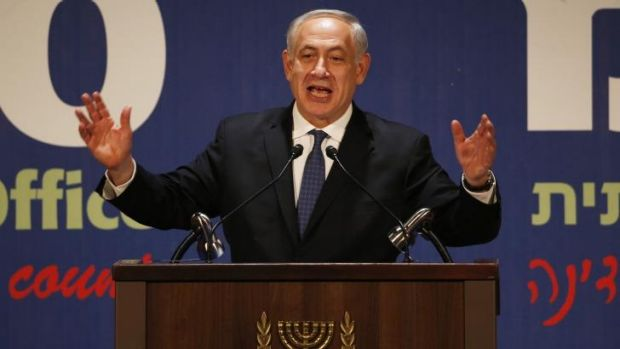 Israel's Prime Minister Benjamin Netanyahu gestures as he addresses the foreign media during a reception marking the new ...
