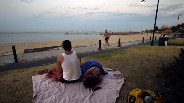 Waking up after a hot night on St Kilda beach.