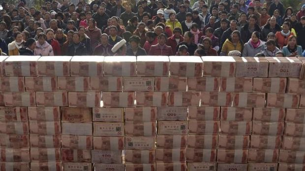 In the money: The wall farmers in Jianshe built with cash from their Lunar New Year bonuses.