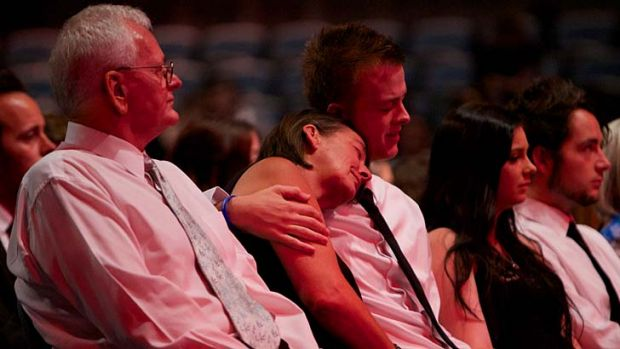 The family of Daniel Christie grieve during his funeral service on Friday.