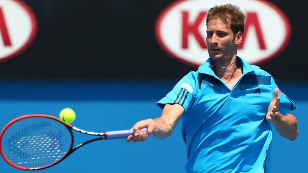 Florian Mayer of Germany in action against Jerzy Janowicz of Poland during day five of the 2014 Australian Open.