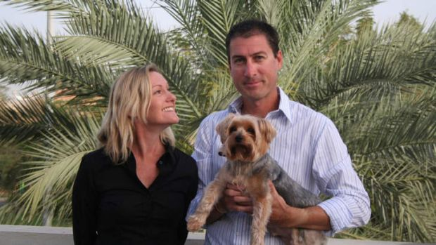 Marcus and Julie Lee in Dubai, with their dog Dudley.
