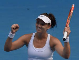 Casey Dellacqua celebrates her victory over China's Zheng Jie.