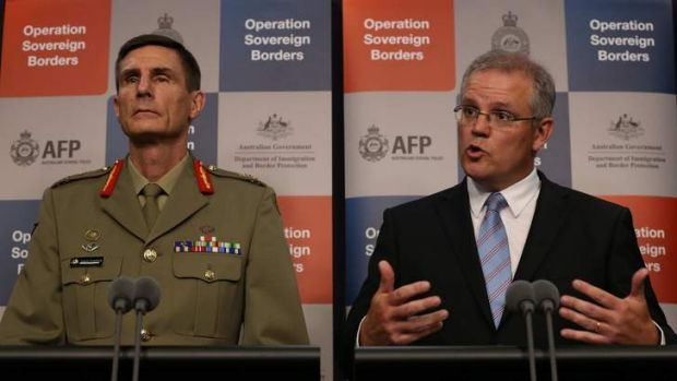 Staying tight lipped over the incursions: Lieutenant-General Angus Campbell, left, and the Immigration Minister Scott ...