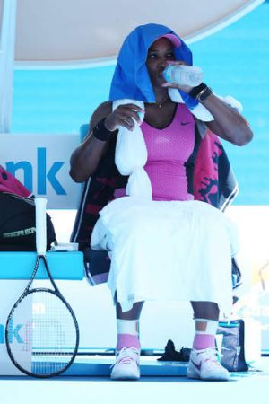 Hot stuff: Serena Williams tries to cool off in her match against Daniela Hantuchova.